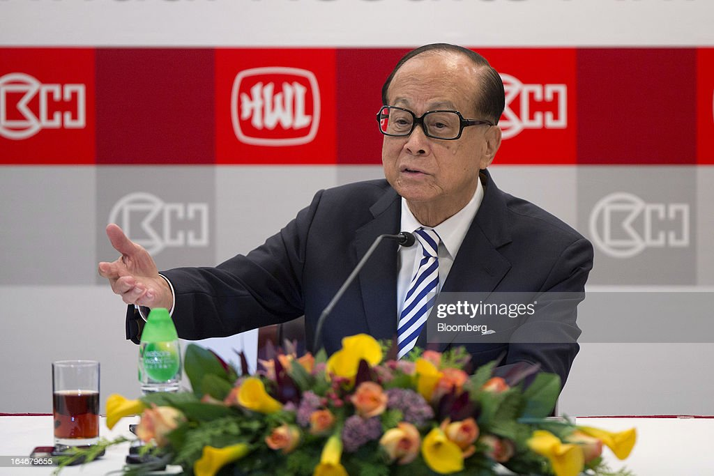Billionaire <a gi-track='captionPersonalityLinkClicked' href=/galleries/search?phrase=Li+Ka-shing&family=editorial&specificpeople=618931 ng-click='$event.stopPropagation()'>Li Ka-shing</a>, chairman of Cheung Kong (Holdings) Ltd. and Hutchison Whampoa Ltd., gestures as he speaks during a news conference in Hong Kong, China, on Tuesday, March 26, 2013. Cheung Kong Holdings, the builder controlled by Asia's richest man, said 2012 profit excluding contributions from unit Hutchison Whampoa Ltd. rose 6 percent as rental income growth offset a decline in home sales. Photographer: Jerome Favre/Bloomberg via Getty Images