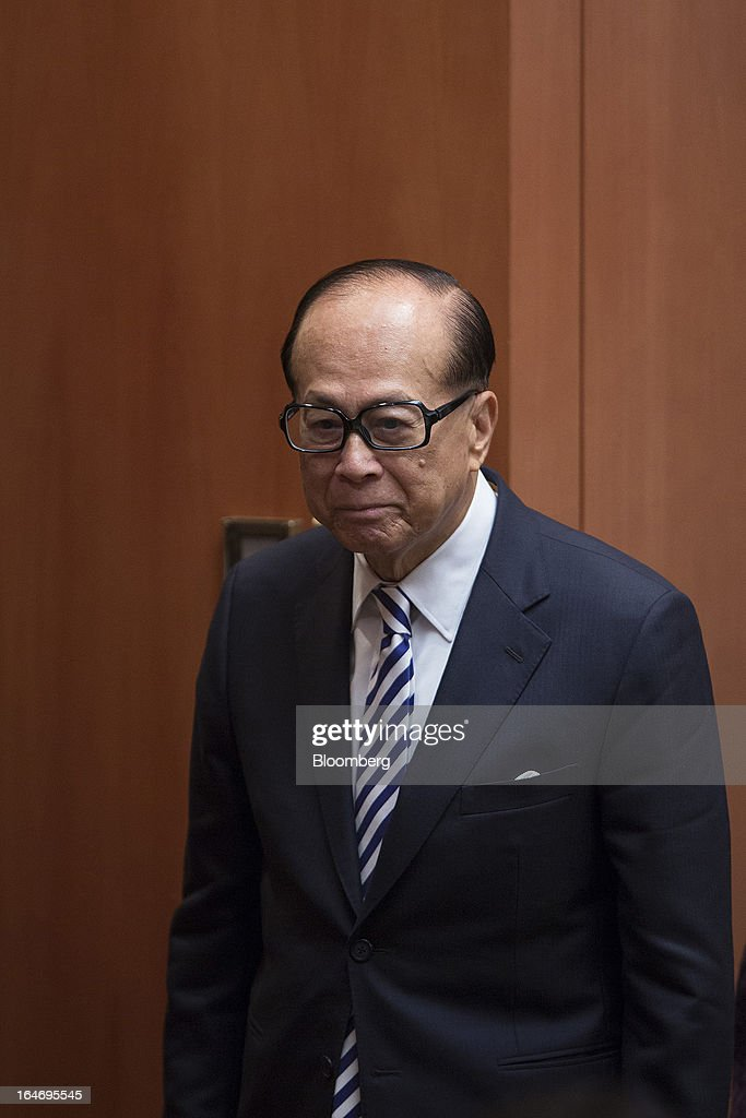 Billionaire Li Ka-shing, chairman of Cheung Kong (Holdings) Ltd. and Hutchison Whampoa Ltd., leaves after a news conference in Hong Kong, China, on Tuesday, March 26, 2013. Cheung Kong Holdings, the builder controlled by Asia's richest man, said 2012 profit excluding contributions from unit Hutchison Whampoa Ltd. rose 6 percent as rental income growth offset a decline in home sales. Photographer: Jerome Favre/Bloomberg via Getty Images