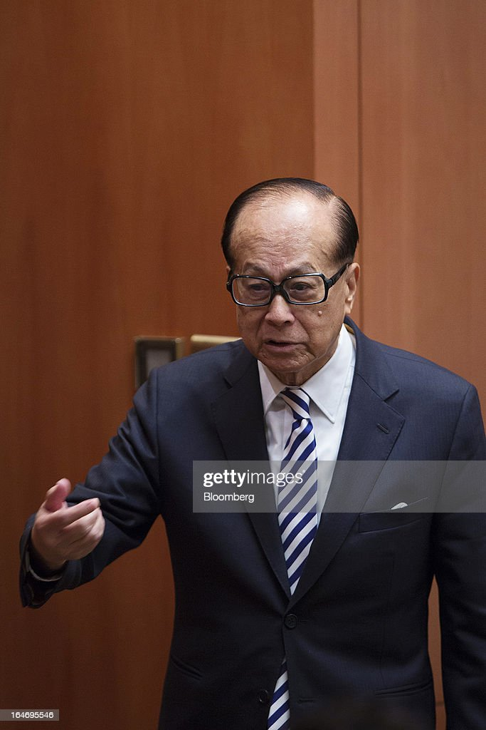 Billionaire <a gi-track='captionPersonalityLinkClicked' href=/galleries/search?phrase=Li+Ka-shing&family=editorial&specificpeople=618931 ng-click='$event.stopPropagation()'>Li Ka-shing</a>, chairman of Cheung Kong (Holdings) Ltd. and Hutchison Whampoa Ltd., speaks with reporters after a news conference in Hong Kong, China, on Tuesday, March 26, 2013. Cheung Kong Holdings, the builder controlled by Asia's richest man, said 2012 profit excluding contributions from unit Hutchison Whampoa Ltd. rose 6 percent as rental income growth offset a decline in home sales. Photographer: Jerome Favre/Bloomberg via Getty Images