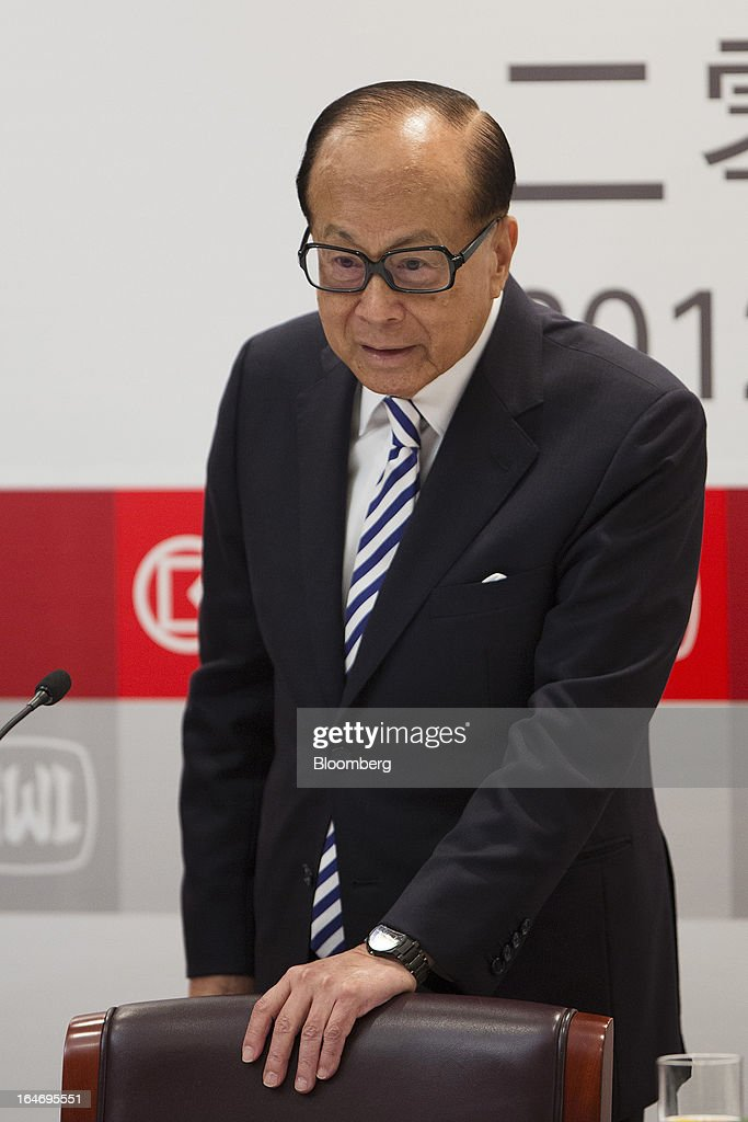 Billionaire Li Ka-shing, chairman of Cheung Kong (Holdings) Ltd. and Hutchison Whampoa Ltd., speaks with reporters after a news conference in Hong Kong, China, on Tuesday, March 26, 2013. Cheung Kong Holdings, the builder controlled by Asia's richest man, said 2012 profit excluding contributions from unit Hutchison Whampoa Ltd. rose 6 percent as rental income growth offset a decline in home sales. Photographer: Jerome Favre/Bloomberg via Getty Images