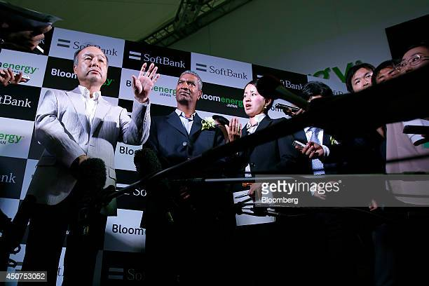 Billionaire Masayoshi Son chairman and chief executive officer of SoftBank Corp left and KR Sridhar cofounder and chief executive officer of Bloom...