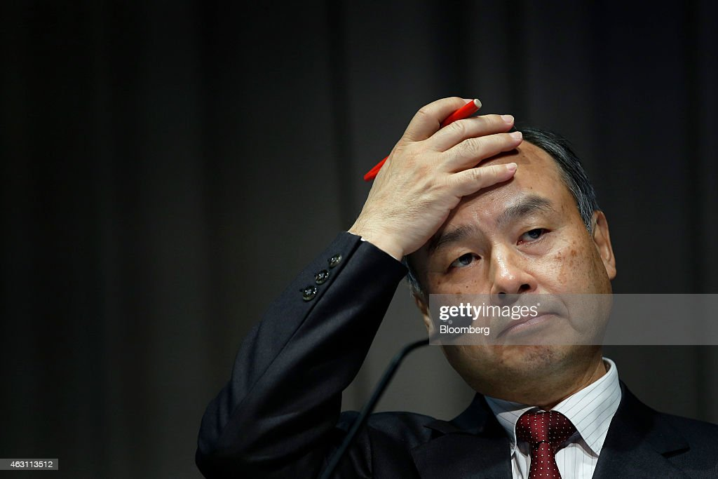 Billionaire Masayoshi Son, chairman and chief executive officer of SoftBank Corp., reacts during a news conference in Tokyo, Japan, on Tuesday, Feb. 10, 2015. SoftBank, the wireless carrier controlled by Son, posted plunging third-quarter profit as Japanese subscriber growth stalled and losses widened at Sprint Corp. in the U.S. Photographer: Kiyoshi Ota/Bloomberg via Getty Images