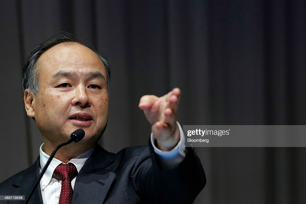 Billionaire Masayoshi Son, chairman and chief executive officer of SoftBank Corp., points to a journalist as he takes questions during a news conference in Tokyo, Japan, on Tuesday, Feb. 10, 2015. SoftBank, the wireless carrier controlled by Son, posted plunging third-quarter profit as Japanese subscriber growth stalled and losses widened at Sprint Corp. in the U.S. Photographer: Kiyoshi Ota/Bloomberg via Getty Images