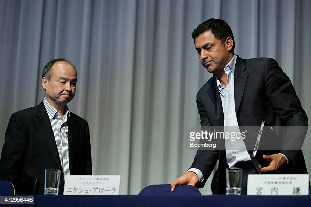 Billionaire Masayoshi Son chairman and chief executive officer of SoftBank Corp left and Nikesh Arora vice chairman leave a news conference in Tokyo...