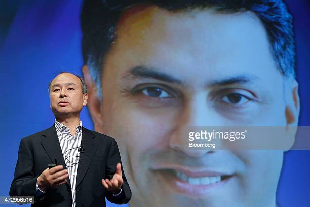 Billionaire Masayoshi Son chairman and chief executive officer of SoftBank Corp speaks as he introduces Nikesh Arora vice chairman during a news...