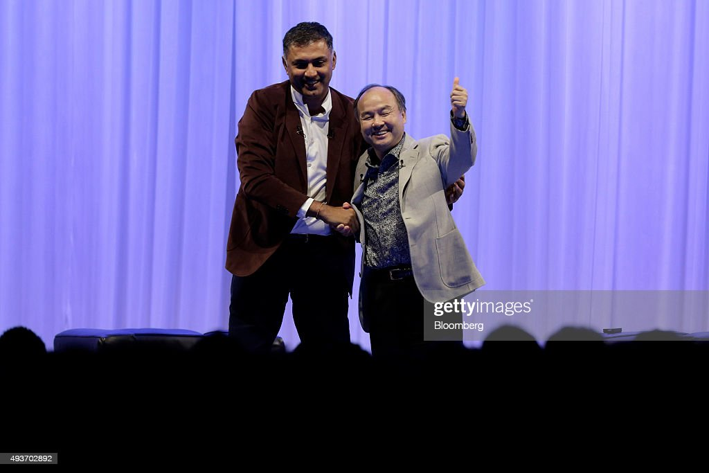 Billionaire <a gi-track='captionPersonalityLinkClicked' href=/galleries/search?phrase=Masayoshi+Son&family=editorial&specificpeople=632759 ng-click='$event.stopPropagation()'>Masayoshi Son</a>, chairman and chief executive officer of SoftBank Group Corp., right, gestures as he shakes hands with <a gi-track='captionPersonalityLinkClicked' href=/galleries/search?phrase=Nikesh+Arora&family=editorial&specificpeople=2156094 ng-click='$event.stopPropagation()'>Nikesh Arora</a>, president and chief operating officer of SoftBank Group Corp., at the end of a SoftBank Academia lecture in Tokyo, Japan, on Thursday, Oct. 22, 2015. SoftBank expects to invest 'several billions' of dollars a year in promising startups and established businesses as the Japanese company tries to evolve into a truly global corporation and identify its next generation of leaders, Chairman <a gi-track='captionPersonalityLinkClicked' href=/galleries/search?phrase=Masayoshi+Son&family=editorial&specificpeople=632759 ng-click='$event.stopPropagation()'>Masayoshi Son</a> said. Photographer: Kiyoshi Ota/Bloomberg via Getty Images