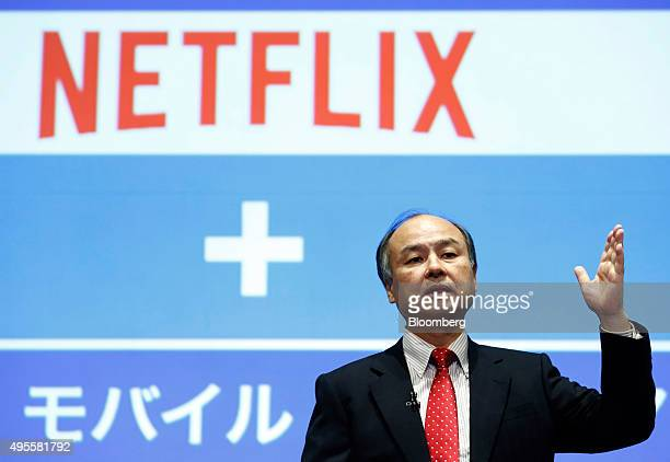 Billionaire Masayoshi Son chairman and chief executive officer of SoftBank Group Corp speaks in front of a Netflix Inc logo during a news conference...