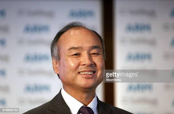 Billionaire Masayoshi Son chairman and chief executive officer of SoftBank Group Corp reacts during a news conference in London UK on Monday July 18...