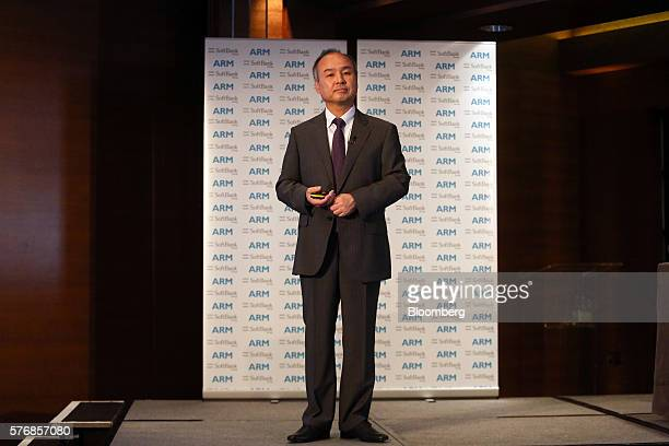 Billionaire Masayoshi Son chairman and chief executive officer of SoftBank Group Corp pauses during a news conference in London UK on Monday July 18...
