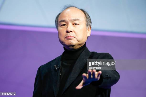 Billionaire Masayoshi Son chairman and chief executive officer of SoftBank Group Corp gestures while delivering a keynote speech on the opening day...