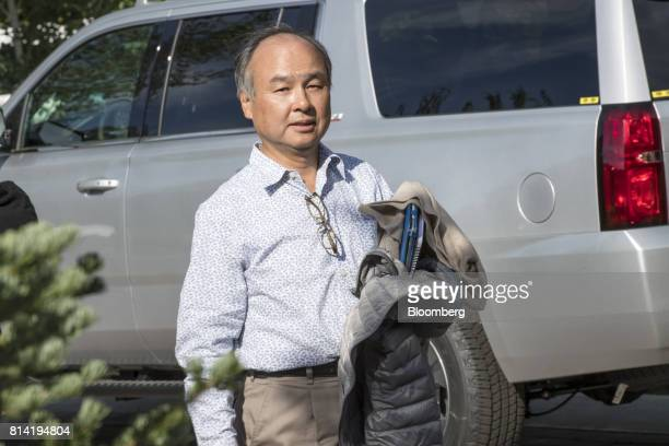 Billionaire Masayoshi Son chairman and chief executive officer of SoftBank Group Corp walks the grounds during the Allen Co Media and Technology...
