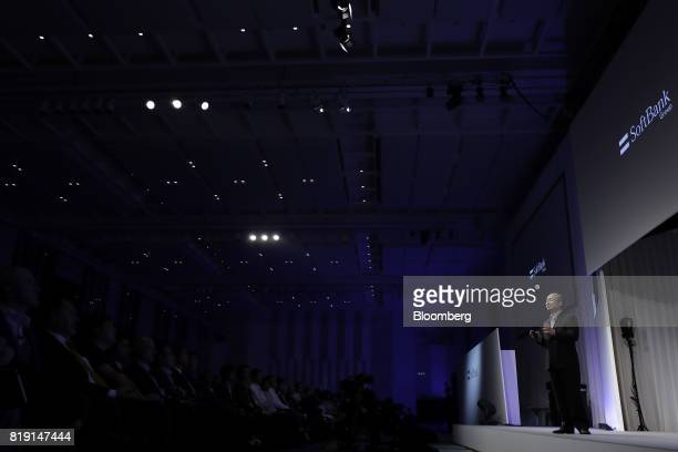 Billionaire Masayoshi Son chairman and chief executive officer of SoftBank Group Corp speaks at SoftBank World 2017 event in Tokyo Japan on Thursday...