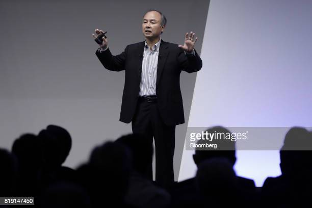 Billionaire Masayoshi Son chairman and chief executive officer of SoftBank Group Corp gestures as he speaks at SoftBank World 2017 event in Tokyo...
