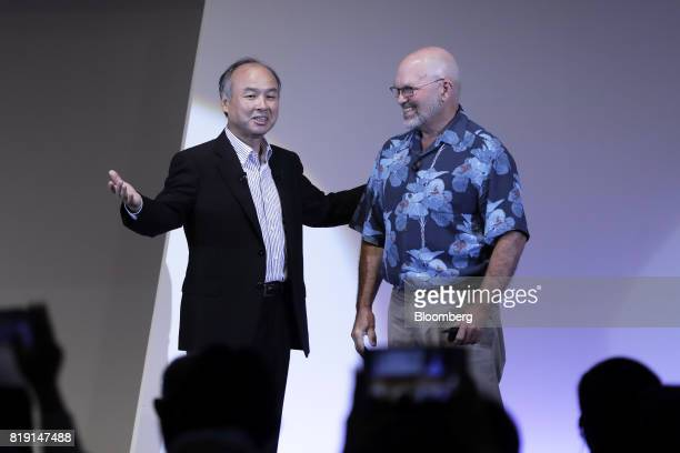 Billionaire Masayoshi Son chairman and chief executive officer of SoftBank Group Corp left introduces Marc Raibert founder and chief executive...