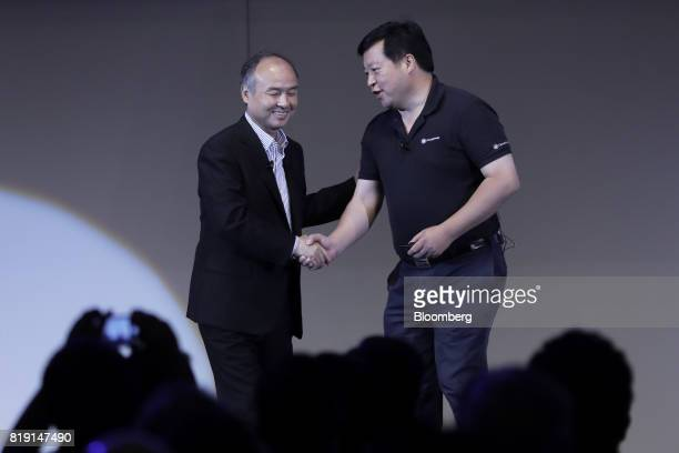 Billionaire Masayoshi Son chairman and chief executive officer of SoftBank Group Corp left and Bill Huang founder and chief executive officer of...