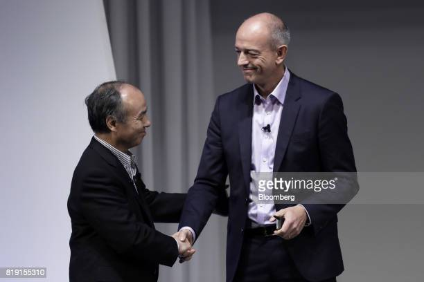 Billionaire Masayoshi Son chairman and chief executive officer of SoftBank Group Corp left and Simon Segars chief executive officer of ARM Holdings...
