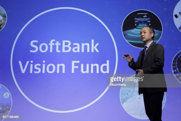 Billionaire Masayoshi Son chairman and chief executive officer of SoftBank Group Corp gestures while speaking during a news conference in Tokyo Japan...