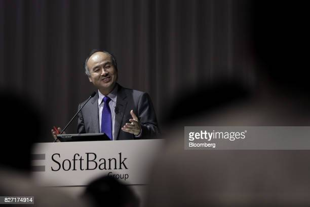 Billionaire Masayoshi Son chairman and chief executive officer of SoftBank Group Corp reacts during a news conference in Tokyo Japan on Monday Aug 7...