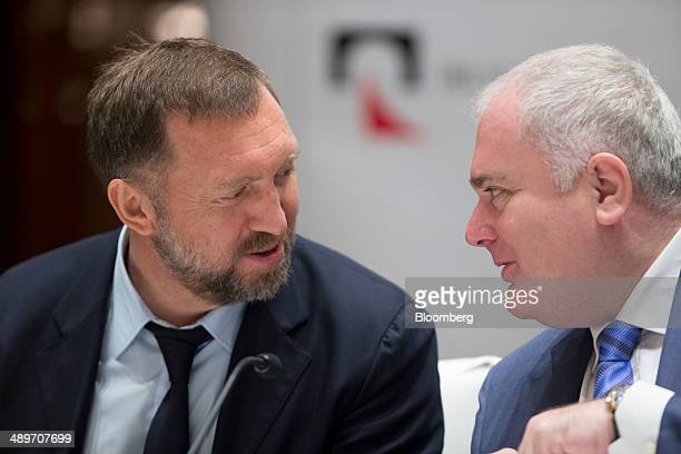Billionaire Oleg Deripaska chief executive officer of United Co Rusal left speaks to Matthias Warnig chairman during a press conference in Hong Kong...