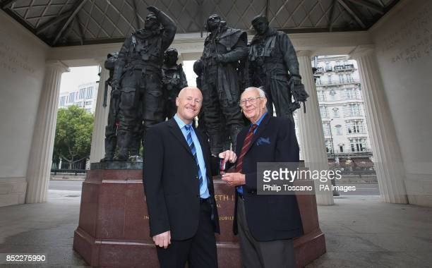 Billionaire philanthropist John Caudwell gives Harry Hooper a Bomber Command clasp at the Bomber Command Memorial in London
