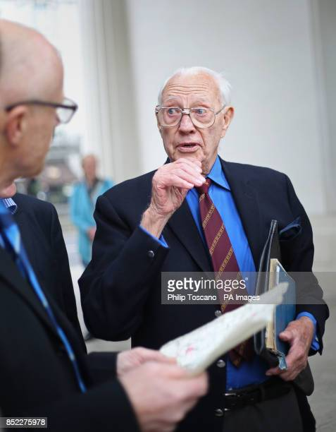 Billionaire philanthropist John Caudwell talking to Harry Hooper after presenting him with a Bomber Command clasp at the Bomber Command Memorial in...