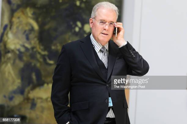 Billionaire Robert Mercer speaks on the phone during the 12th International Conference on Climate Change hosted by The Heartland Institute on March...