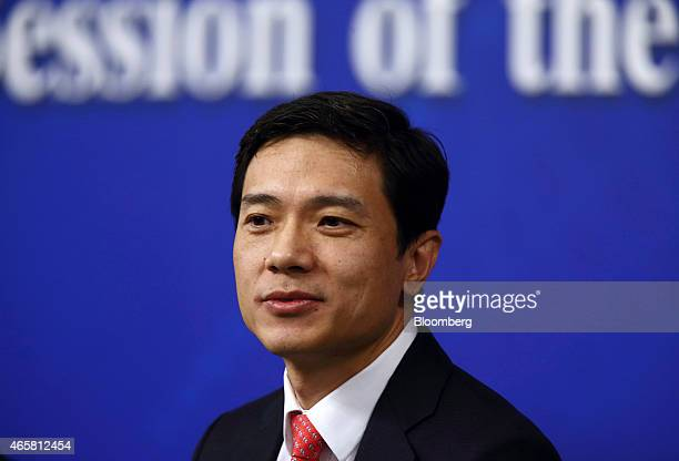 Billionaire Robin Li chief executive officer of Baidu Inc speaks during a news conference in Beijing China on Wednesday March 11 2015 Baidu may...