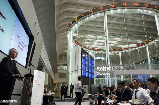 Billionaire Tadashi Yanai chairman and chief executive officer of Fast Retailing Co left speaks during a news conference at the Tokyo Stock Exchange...