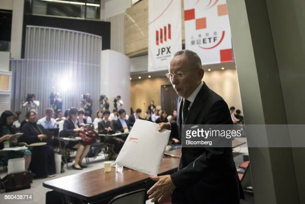 Billionaire Tadashi Yanai chairman and chief executive officer of Fast Retailing Co leaves a news conference at the Tokyo Stock Exchange in Tokyo...
