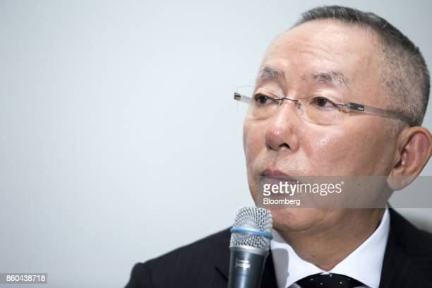 Billionaire Tadashi Yanai chairman and chief executive officer of Fast Retailing Co attends during a news conference at the Tokyo Stock Exchange in...