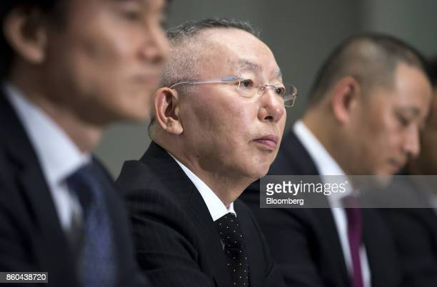 Billionaire Tadashi Yanai chairman and chief executive officer of Fast Retailing Co center attends a news conference at the Tokyo Stock Exchange in...