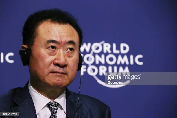 Billionaire Wang Jianlin chairman and president of Dalian Wanda Group listens during a news conference at the World Economic Forum Annual Meeting Of...
