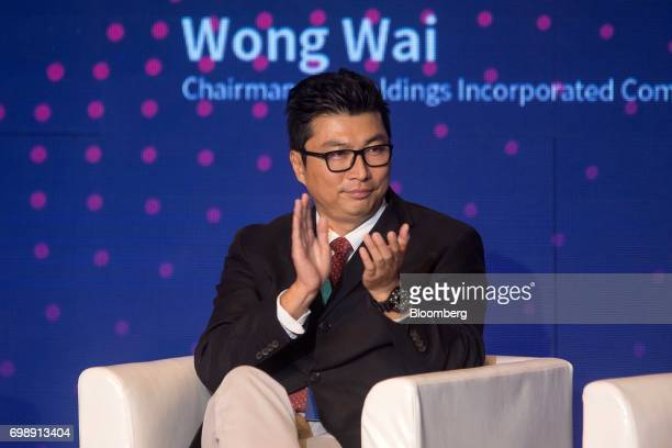 Billionaire Wang Wei chairman of SF Holding Co attends the GuangdongHong KongMacao Greater Bay Area Forum in Hong Kong China on Tuesday June 20 2017...