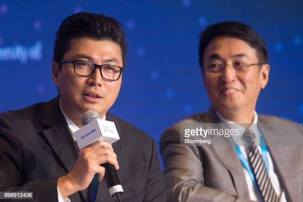 Billionaire Wang Wei chairman of SF Holding Co left speaks as Peter Lee chairman of Henderson China Holdings Ltd looks on at the GuangdongHong...