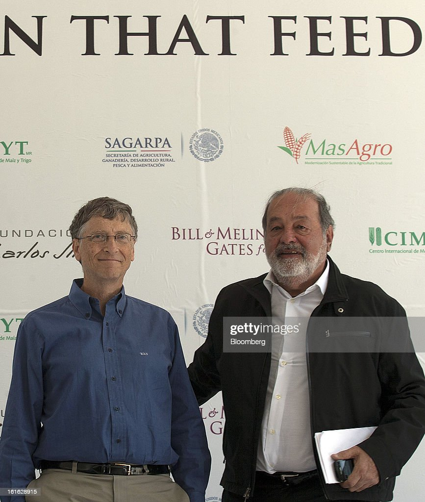 Billionaires Bill Gates, left, and Carlos Slim hold a news conference to announce donations to Mexico's International Maize and Wheat Improvement Center, known by its Spanish initials as CIMMYT, in Texcoco, Mexico, on Wednesday, Feb. 13, 2013. The group, which performs research for agricultural productivity, will open its research facility this week. Photographer: Susana Gonzalez/Bloomberg via Getty Images