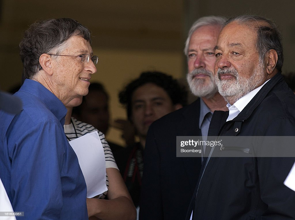 Billionaires Bill Gates, left, and Carlos Slim wait for the start of a news conference to announce donations to Mexico's International Maize and Wheat Improvement Center, known by its Spanish initials as CIMMYT, in Texcoco, Mexico, on Wednesday, Feb. 13, 2013. The group, which performs research for agricultural productivity, opens its research facility this week. Photographer: Susana Gonzalez/Bloomberg via Getty Images