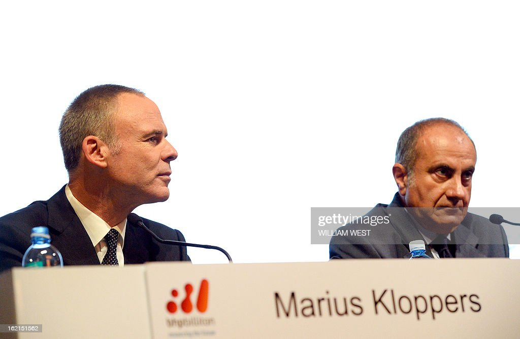 BHP Billiton CEO Marius Kloppers (L) speaks as company chairman Jac Nasser (R) listens as it is announced Kloppers is retiring and will be replaced by Andrew Mackenzie, in Sydney on February 20, 2013. The 56-year-old Mackenzie, currently chief executive non-ferrous, has over 30 years experience in oil and gas, petrochemicals and minerals and joined BHP Billiton in November 2008. South African Kloppers has been running the world's largest miner since October 2007, steering it through the global financial crisis. AFP PHOTO/William WEST