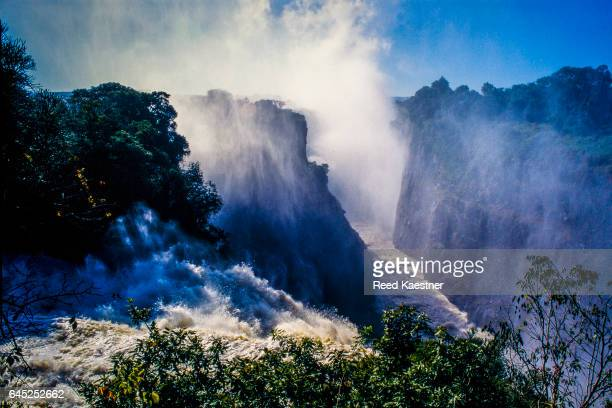 Billowing mist rises from the  Zambezi River as it  flows into the gorge at Victoria Falls