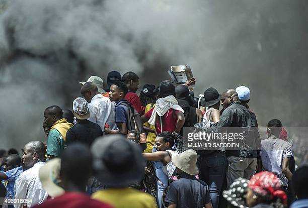 Billowing smoke engulfed students as clashes erupted between protesters and security forces on the site where a portable toilet was set ablaze on the...