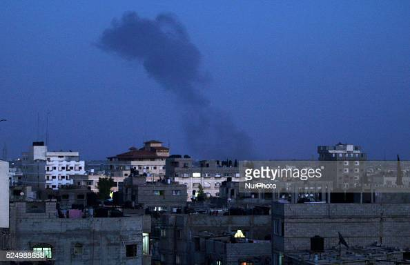 A Billowing smoke from an air strike by Israeli warplanes on the site of the national security near the international Gaza airport in eastern Rafah...