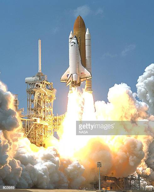 Billows of steam and smoke rise as Space Shuttle Endeavour lifts off on the ninth flight to the International Space Stationon April 19 2001 at...