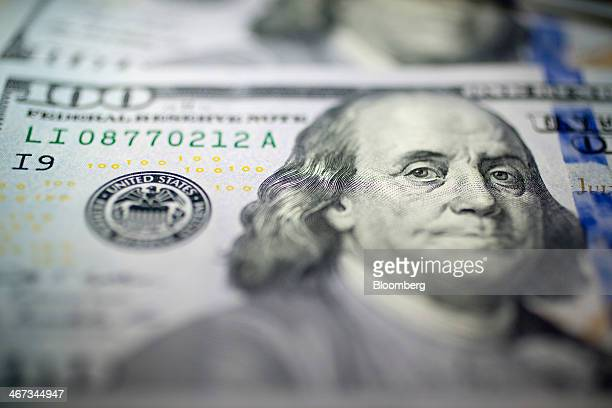 US $100 bills are arranged for a photograph in Washington DC US on Thursday Feb 6 2014 A suspension of the federal debt limit enacted by Congress in...