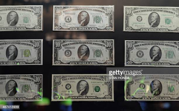 USD $10 bills formally known as Federal Reserve Notes from 9 of the 12 district banks of the Federal Reserve System on display in the exhibition 'The...
