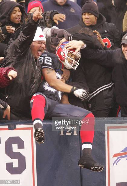 Bills receiver Josh Reed gets some love from the fans in the endzone after scoring a touchdown during the game against the Miami Dolphins at Ralph...