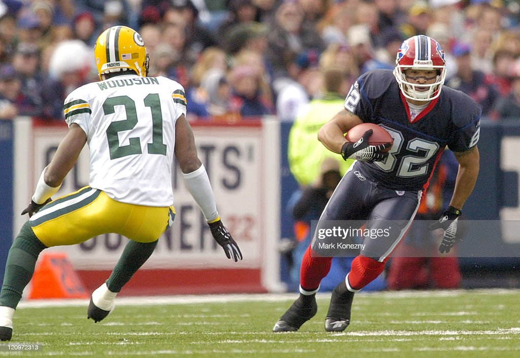 Bills wide receiver Josh Reed runs past Packers defender Charles Woodson after making a catch during game between the Green Bay Packers and the...