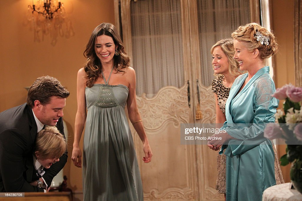 Billy Abbott (Billy Miller, left) surprises his wife Victoria Newman Abbott (Amelia Heinle, second from left) with her son, Reed Hellstrom (Max Page, lower left) at the remarriage of her parents, Nikki (Melody Thomas Scott, far right) and Victor Newman, on THE YOUNG AND THE RESTLESS. Also pictured, Marcy Rylan as Abby Newman, second from right. The wedding is scheduled to air Wednesday, March 20 on the CBS Television Network.