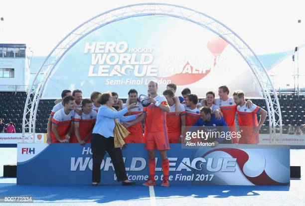 Billy Bakker of the Netherlands receives the trophy during the final match between Argentina and the Netherlands on day nine of the Hero Hockey World...