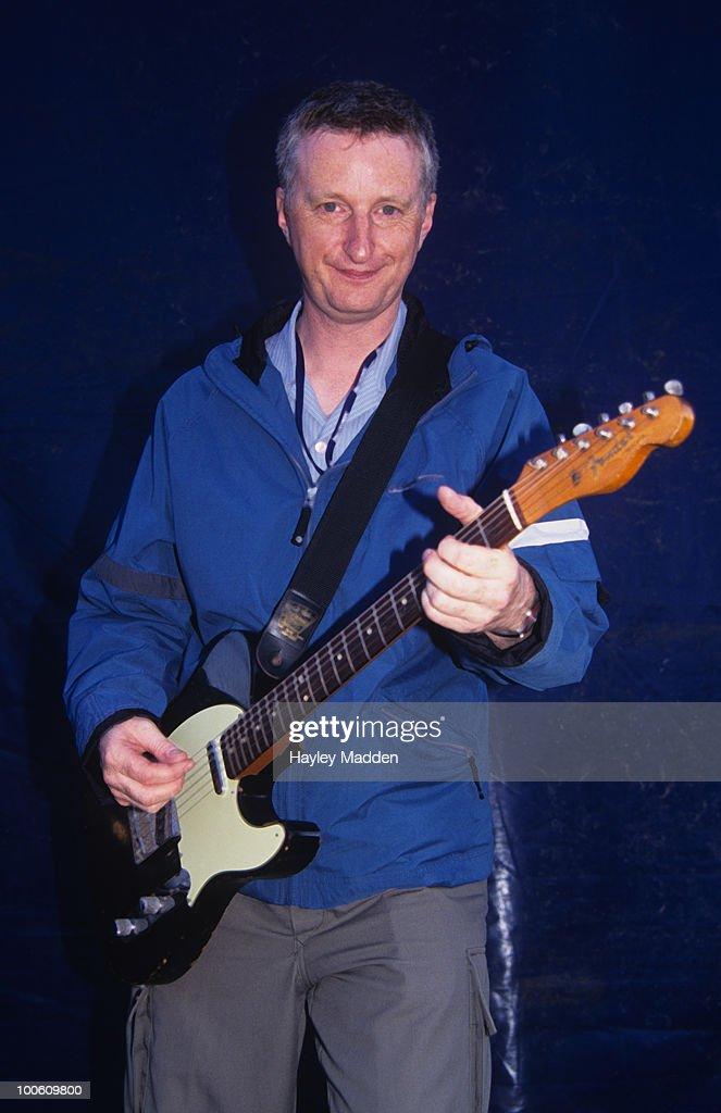 Billy Bragg backstage with a Fender Stratocaster guitar circa 2000.