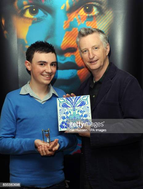Billy Bragg holding a ceramic tile and Matthew Lewis from the Rhonnda Valleys in South Wales aged 17 holding a sand timer as part of Stories of the...