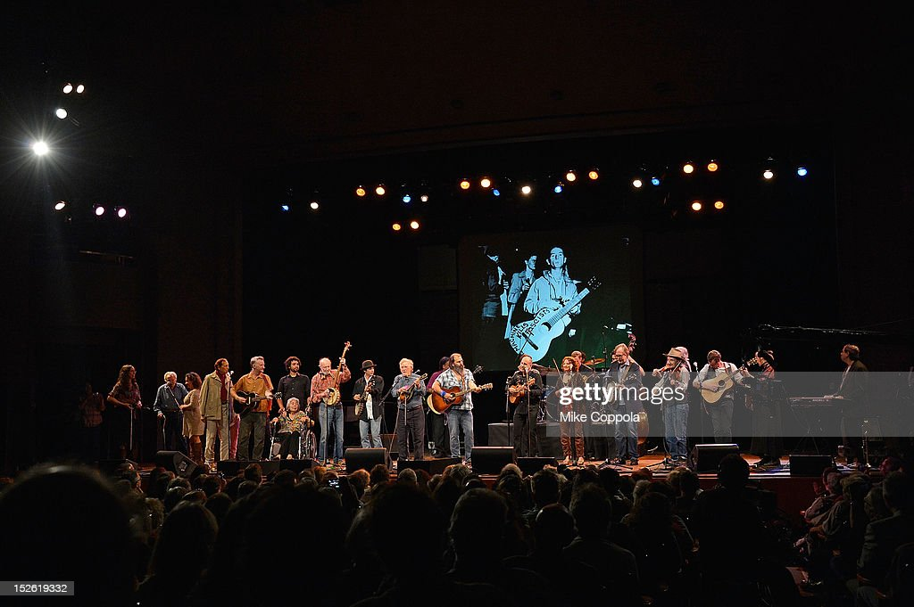 Billy Bragg (4th from L), Pete Seeger (8th from L) and Steve Earle (12th from L) perform during the 'This Land Is Your Land' Woody Guthrie At 100 Concert as part of the Woody Guthrie Centennial Celebration at The Whitman Theater at Brooklyn College on September 22, 2012 in New York City.